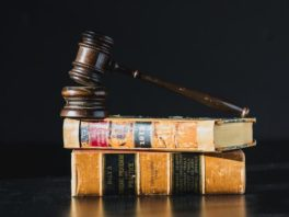 judge's gavel on law books