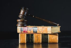 judge's gavel on law books